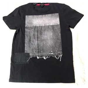 Diesel, black shirt, and with jean on it